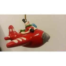 Pupazzo di neve su aereo rosso